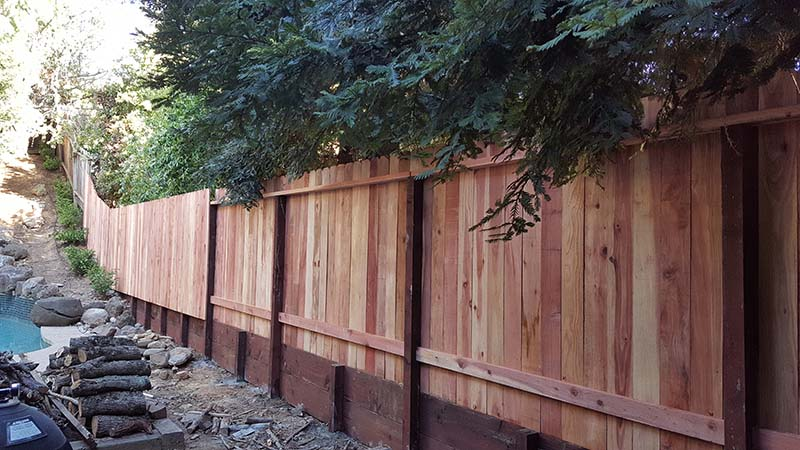 wood dog ear on retaining wall