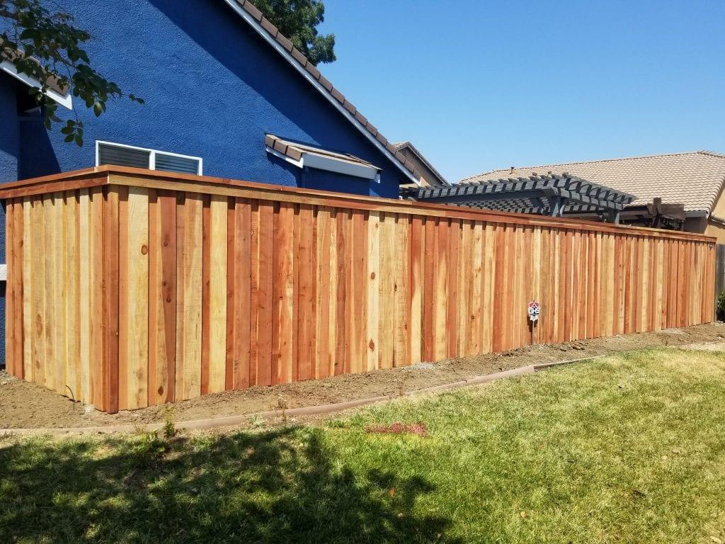 Board on Board Cap and Trim style Fence – 21